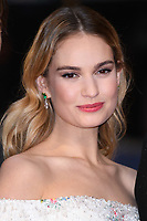 """Lily James<br /> arriving for the world premiere of """"The Guernsey Literary and Potato Peel Pie Society"""" at the Curzon Mayfair, London<br /> <br /> ©Ash Knotek  D3394  09/04/2018"""