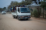Tete City, Tete Province of Mozambique.  Workers on their way to the coal mines. Tete is currently booming due to its large coal ressources explored mostly by foreign companies like Vale or Riversdale/Rio Tinto.
