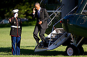 United States President Barack Obama salutes the Marine Guard as he walks off of Marine One after landing on the South Lawn of the White House in Washington, D.C., U.S., on Tuesday, Aug. 25, 2015. Obama pledged yesterday to provide incentives to support investments in renewable energy, saying the industry will thrive despite opposition by Republicans and fossil-fuel suppliers. <br /> Credit: Andrew Harrer / Pool via CNP
