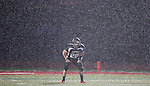 Cheyenne Central's Tallon Bullock waits in heavy rain for players to line up for a kickoff against Gillette at Riske Field Friday night. Michael Smith/staff