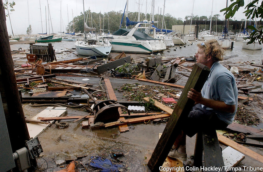 Fairhope, ALA 8/29/05-Zane Yoder of Daphne, Ala. surveys the mess made of the Fairhope Yacht Club after Hurricane Katrina came ashore Monday. Yoder owns two boats at the club, one of them was destroyed by the storm. COLIN HACKLEY PHOTO