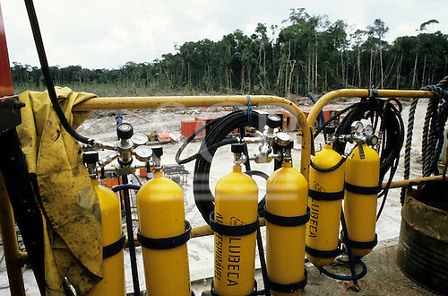 Caraoari, Brazil. Oil exploration site in the middle of the Amazon rainforest; yellow gas cylinders.