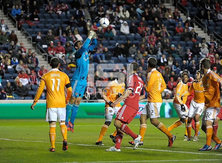 Houston goalkeeper Tally Hall (1) punches away a corner kick.  The Houston Dynamo defeated the Chicago Fire 2-1 in the Eastern Conference play-in game for the MLS Playoffs at Toyota Park in Bridgeview, IL on October 31, 2012.