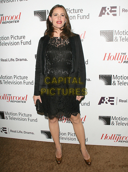 Jennifer Garner.'Reel Stories, Real Lives' Celebration of the Motion Picture & Television Fund' 90 Years of Service to the Community and Recognizes The Hollywood Reporter's Next Generation Class of 2011 held at Milk Studios in Los Angeles, California, USA..full length dress pregnant jacket blazer clutch bag black lace brown shoes .CAP/RKE/DVS.©DVS/RockinExposures/Capital Pictures.