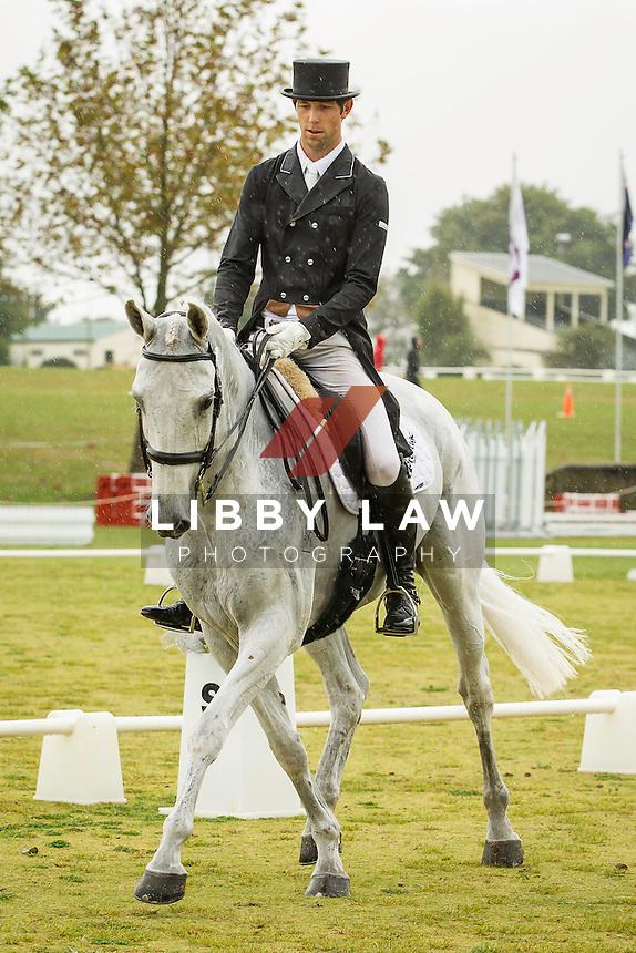 NZL-Clarke Johnstone (BALMORAL SENSATION) INTERIM-3RD: CIC3* DRESSAGE: 2014 NZL-BNZ Kihikihi International Horse Trial (Friday 11 April) CREDIT: Libby Law COPYRIGHT: LIBBY LAW PHOTOGRAPHY - NZL