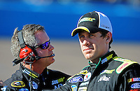 Apr 17, 2009; Avondale, AZ, USA; NASCAR Sprint Cup Series driver Carl Edwards (right) with crew chief Bob Osborne during qualifying for the Subway Fresh Fit 500 at Phoenix International Raceway. Mandatory Credit: Mark J. Rebilas-