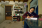 Yarely Arellano does homework in her home in Juarez, Mexico. She crosses the international border every day to study at the Lydia Paterson Institute, a United Methodist sponsored high school in El Paso, Texas.