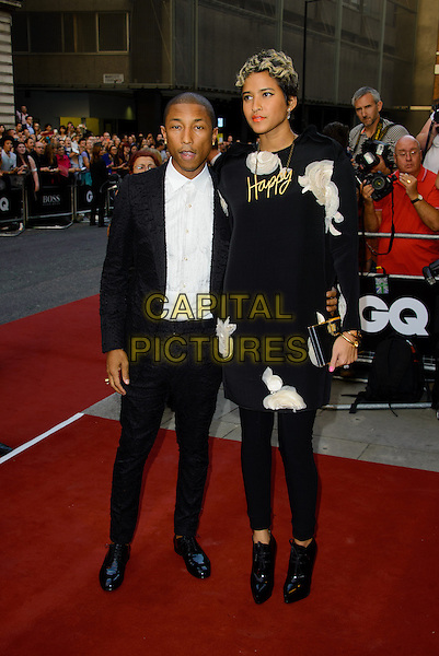Pharrell Williams &amp; Helen Lasichanh<br /> GQ Men of the Year Awards 2013 at the Royal Opera House, London, England.<br /> September 3rd, 2013<br /> full length black dress suit white shirt floral print happy word necklace clutch bag married husband wife gold <br /> CAP/CJ<br /> &copy;Chris Joseph/Capital Pictures