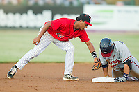 Casey Kalenkosky (32) of the Rome Braves slides into second base ahead of the tag by Kannapolis Intimidators shortstop Cleuluis Rondon (13) at CMC-Northeast Stadium on August 24, 2013 in Kannapolis, North Carolina.  The Intimidators defeated the Braves 6-1.  (Brian Westerholt/Four Seam Images)