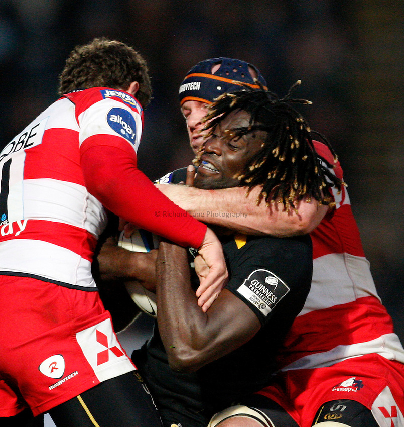 Photo: Richard Lane/Richard Lane Photography. London Wasps v Gloucester Rugby. LV= Cup. 15/11/2009. Wasps' Paul Sackey is tackled high by Gloucester's Peter Buxton.