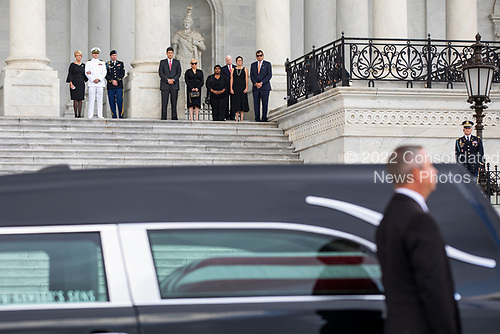 Members of the McCain family (top) watch joint service members of a military casket team prepare to carry the casket of Senator John McCain into the US Capitol, where he will lie in state for the rest of the day in Washington, DC, USA, 31 August 2018. McCain died 25 August, 2018 from brain cancer at his ranch in Sedona, Arizona, USA. He was a veteran of the Vietnam War, served two terms in the US House of Representatives, and was elected to five terms in the US Senate. McCain also ran for president twice, and was the Republican nominee in 2008.