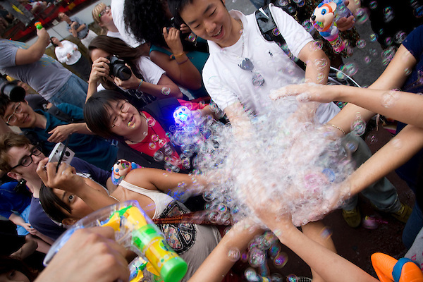 """Loosely based on Dr. Seuss book """"The Butter Battle Book,"""" people converge in New York City's Times Square for Bubble Battle NYC on 26 June 2010, blowing bubbles with toys, bubble solution, and other bubble generators."""