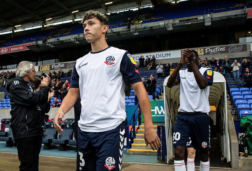 Bolton Wanderers' Eddie Brown and Yoan Zouma (right) take to the pitch<br /> <br /> Photographer Andrew Kearns/CameraSport<br /> <br /> EFL Leasing.com Trophy - Northern Section - Group F - Bolton Wanderers v Bradford City -  Tuesday 3rd September 2019 - University of Bolton Stadium - Bolton<br />  <br /> World Copyright © 2018 CameraSport. All rights reserved. 43 Linden Ave. Countesthorpe. Leicester. England. LE8 5PG - Tel: +44 (0) 116 277 4147 - admin@camerasport.com - www.camerasport.com