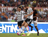 Calcio, Serie A: Roma vs Juventus. Roma, stadio Olimpico, 30 agosto 2015.<br /> Juventus&rsquo; Roberto Pereyra, left, and Alvaro Morata fight for the ball against Roma&rsquo;s Seydou Keita, right, during the Italian Serie A football match between Roma and Juventus at Rome's Olympic stadium, 30 August 2015.<br /> UPDATE IMAGES PRESS/Isabella Bonotto