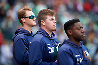Fort Wayne TinCaps Blake Hunt (12), Ryan Weathers (25), and Lee Solomon (4) during the National Anthem before a Midwest League game against the Kane County Cougars at Parkview Field on May 1, 2019 in Fort Wayne, Indiana. Fort Wayne defeated Kane County 10-4. (Zachary Lucy/Four Seam Images)