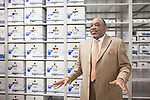 Ed Harris, Chief of Field Support Services in the City of Austin Police Department, stands in front of shelves of evidence, including rape kits, in a climate controlled warehouse in Austin, Texas.