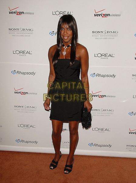 NATALIE COLE.attends The Clive Davis Pre-Grammy Party .held at The Beverly Hilton Hotel in Beverly Hills, California, USA,  February 10 2007..full length black dress.CAP/DVS.©Debbie VanStory/Capital Pictures