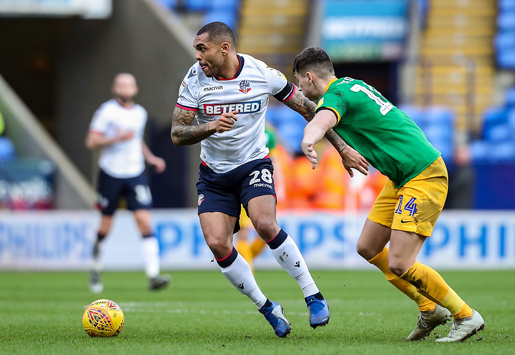 Bolton Wanderers' Josh Magennis competing with Preston North End's Jordan Storey  <br /> <br /> Photographer Andrew Kearns/CameraSport<br /> <br /> The EFL Sky Bet Championship - Bolton Wanderers v Preston North End - Saturday 9th February 2019 - University of Bolton Stadium - Bolton<br /> <br /> World Copyright © 2019 CameraSport. All rights reserved. 43 Linden Ave. Countesthorpe. Leicester. England. LE8 5PG - Tel: +44 (0) 116 277 4147 - admin@camerasport.com - www.camerasport.com