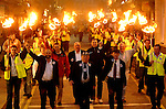 Jackie Healy-Rae leads his fire burning turf men down Plunkett Street, Killarney on their final rally before the general election of 2007.<br />Picture by Don MacMonagle