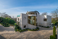 BNPS.co.uk (01202 558833)<br /> Pic: SothebysRealty/BNPS<br /> <br /> Highgate mega-home hits the market for an eye watering $40 million.<br /> <br /> A luxury mansion in one of London's most exclusive suburbs has emerged on the market for a staggering £40million.<br /> <br /> Heathfield House is in the heart of Highgate, north London, home to famous figures including Jude Law, Liam Gallagher and Kate Moss.<br /> <br /> The stunning 10 bedroom house, which comes with two acres of landscaped gardens, is a stone's throw from Hampstead Heath. <br /> <br /> It has a giant 94ft by 39ft swimming pool and its own spa, as well as an aquarium and a tennis court.<br /> <br /> The property, which has separate staff lodgings, is being sold with estate agent Sotheby's International Realty.