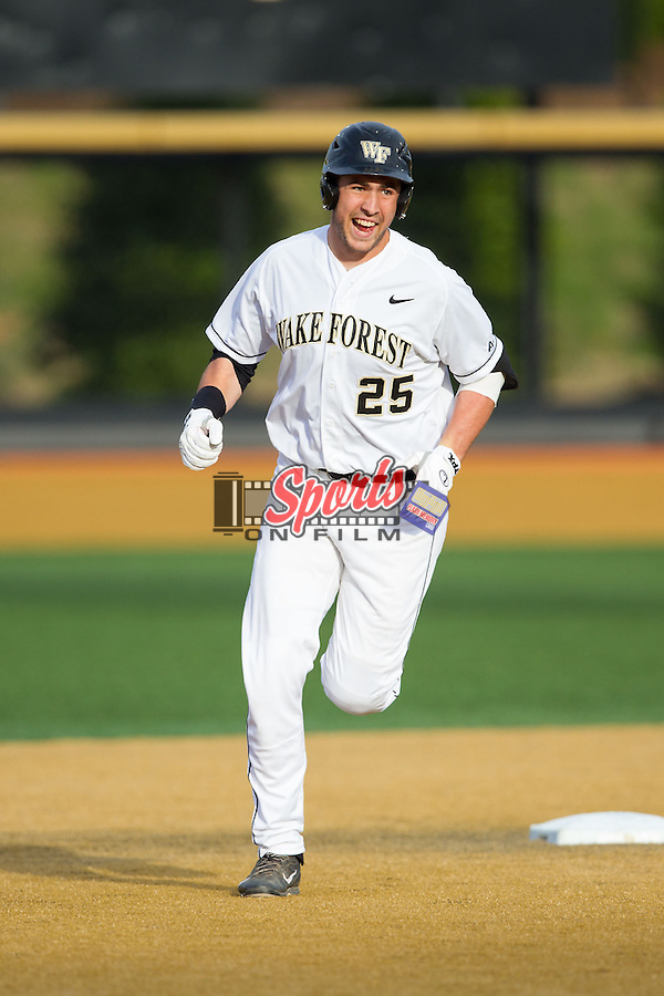 Matt Conway (25) of the Wake Forest Demon Deacons rounds second base after hitting a home run against the Maryland Terrapins at Wake Forest Baseball Park on April 4, 2014 in Winston-Salem, North Carolina.  The Demon Deacons defeated the Terrapins 6-4.  (Brian Westerholt/Sports On Film)