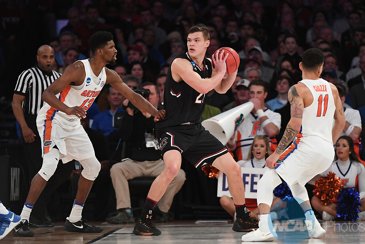NEW YORK, NY - MARCH 26: Maik Kotsar #21 of the South Carolina Gamecocks is guarded by Kevarrius Hayes #13 of the Florida Gators during the 2017 NCAA Men's Basketball Tournament held at Madison Square Garden on March 26, 2017 in New York City. (Photo by Justin Tafoya/NCAA Photos via Getty Images)