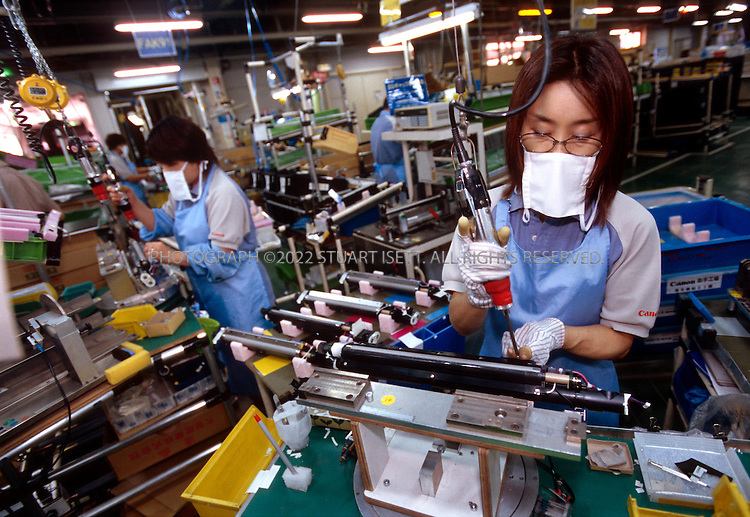 8/5/02--Arakawaoki, Japan..Employees at Canon's Ami Plant assemble color copy machines..All photographs ©2003 Stuart Isett.All rights reserved.This image may not be reproduced without expressed written permission from Stuart Isett.