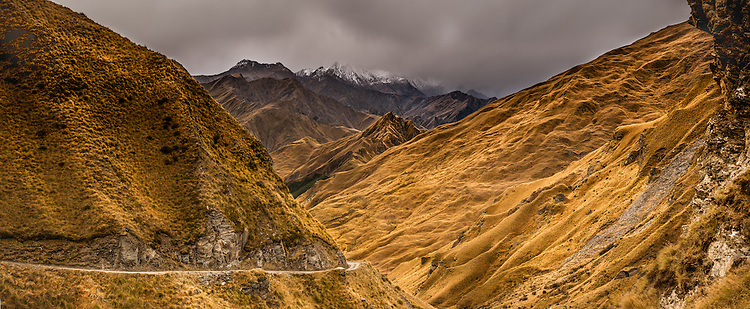 Photo of the rugged Skippers Canyon road with early autumn snow on the Richardson Mountains. Queenstown, South Island, New Zealand - stock photo, canvas, fine art print