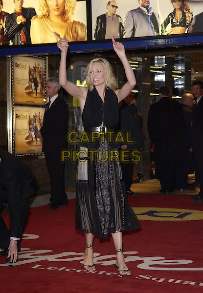 "UMA THURMAN.""Be Cool"" Premiere Leicester Square, London, WC2.March 7th, 2005.full length black sheer chiffon dress hands in air pointing gesture.www.capitalpictures.com.sales@capitalpictures.com.© Capital Pictures."