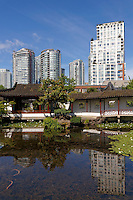 Dr. Sun Yat-Sen Classical Chinese Garden with downtown condominium towers, Chinatown, Vancouver, BC, Canada