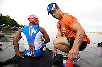 Minda speaks with one of her handlers, Rob, at the starting line of the Aquaphor New York City Triathlon in New York on July 8, 2012.