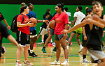 WATERBURY,  CT-080919JS06--Former local players Julia Quinn of Thomaston, left, and Rashana Siders of Holy Cross, right, came back as coaches for Ta'Quan Zimmerman's Be A Baller Not A Bully basketball camp Friday at Wilby High School in Waterbury. <br /> Jim Shannon Republican-American
