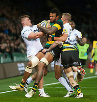 Courtney Lawes of Northampton Saints is double-tackled. Aviva Premiership match, between Northampton Saints and Bath Rugby on September 15, 2017 at Franklin's Gardens in Northampton, England. Photo by: Patrick Khachfe / Onside Images