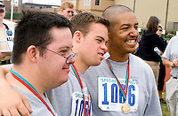 Athletes age 18 posing for picture with award medals. Special Olympics U of M Bierman Field. Minneapolis Minnesota USA