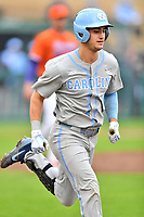 North Carolina Tar Heels catcher Brandon Martorano (4) runs to first base during a game against the Clemson Tigers at Doug Kingsmore Stadium on March 9, 2019 in Clemson, South Carolina. The Tigers defeated the Tar Heels 3-2 in game one of a double header. (Tony Farlow/Four Seam Images)