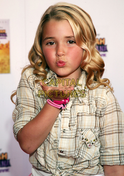 "EMILY GRACE REAVES .""Hannah Montana: The Movie"" Nashville Screening held at Regal Cinemas, Nashville, TN, USA..April 9th, 2009.half length hand blowing kiss brown cream checked pink bracelet.CAP/ADM/RR.©Randi Radcliff/AdMedia/Capital Pictures."