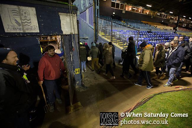 Southend United 1 Burton Albion 1, 22/02/2016. Roots Hall, League One. A groundsman emerges from his hut as home supporters make their way from Roots Hall stadium, after Southend United took on Burton Albion in a League 1 fixture. Founded in 1906, Southend United moved into their current ground in 1955, the construction of which was funded by the club's supporters. Southend won this match by 3-1, watched by a crowd of 6503. Photo by Colin McPherson.
