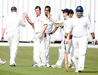 Martin Tucker (C) is congratulated after dismissing A Javed (R) during the Middlesex County Cricket League Division Two game between Hornsey and Harrow Town at Tivoli Road, Crouch End on Sat Sept 3, 2011