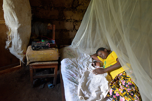 A mother with her three-week old newborn in Batamuliza Hururiro village, near Rukumo Health Center, Rwanda....
