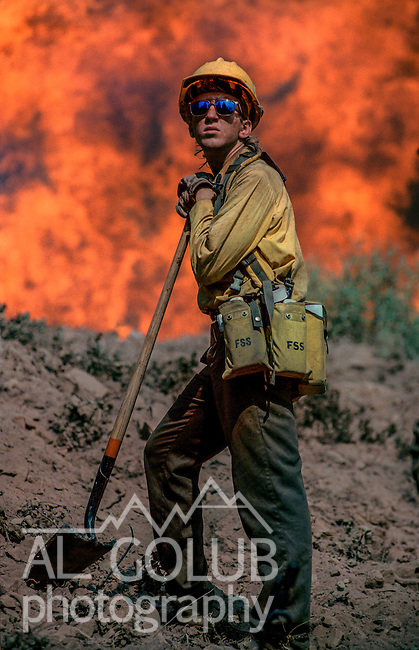 August 13, 1990 Yosemite National Park  --  A-Rock (Arch Rock) Fire  -- Firefighter Greg Christensen momentarily pauses to look around during burning operations. The Arch Rock Fire burned over 16,000 acres of Yosemite National Park and the Stanislaus National Forest.  At the same time across the Merced River, the Steamboat Fire burned over 5,000 acres of both Yosemite National Park and the Sierra National Forest.