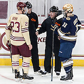 Patrick Brown (BC - 23), Scott Hansen, Jeff Bunyon, Jeff Costello (ND - 11) - The Boston College Eagles defeated the visiting University of Notre Dame Fighting Irish 4-2 to tie their Hockey East quarterfinal matchup at one game each on Saturday, March 15, 2014, at Kelley Rink in Conte Forum in Chestnut Hill, Massachusetts.