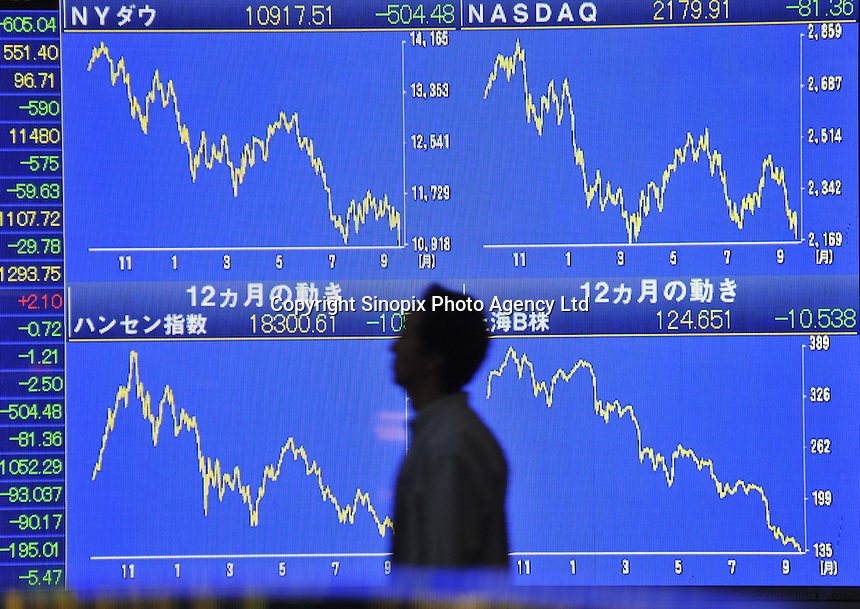 A board indicating the massive drop in global stocks after the news of the Lehman bank closure. The Nikkei 225 stock average shed 605.04 points, or 4.95 percent, to 11,609.72 - its lowest close since July 2005. The broader Topix fell 5.07 percent to 1,117.57..
