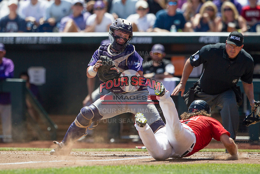 TCU Horned Frogs catcher Evan Skoug (9) reaches to apply the tag at the plate as Texas Tech Red Raiders baserunner Tanner Gardner (8) slides safely home during Game 3 of the NCAA College World Series on June 19, 2016 at TD Ameritrade Park in Omaha, Nebraska. TCU defeated Texas Tech 5-3. (Andrew Woolley/Four Seam Images)