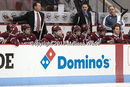 Greg Carvel (UMass - Head Coach), Jared DeMichiel (UMass - Assistant Coach), Jeff Smith (UMass - Associate AD-Sports Medicine) - The Boston University Terriers defeated the University of Massachusetts Minutemen 3-1 on Friday, February 3, 2017, at Agganis Arena in Boston, Massachusetts.The Boston University Terriers defeated the visiting University of Massachusetts Amherst Minutemen 3-1 on Friday, February 3, 2017, at Agganis Arena in Boston, MA.