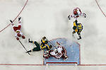 ST CHARLES, MO - MARCH 19:  Ann-Renée Desbiens (30) of the Wisconsin Badgers moves to cover the puck during the Division I Women's Ice Hockey Championship held at The Family Arena on March 19, 2017 in St Charles, Missouri. Clarkson defeated Wisconsin 3-0 to win the national championship. (Photo by Mark Buckner/NCAA Photos via Getty Images)