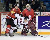 Patrick Geering (Switzerland - 4), Gvido Kauss (Latvia - 4), Benjamin Conz (Switzerland - 1) - Team Switzerland defeated Team Latvia 7-5 on Wednesday, December 30, 2009, at the Credit Union Centre in Saskatoon, Saskatchewan, during the 2010 World Juniors tournament.