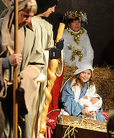 Kat Johnson (right), 10, of Morrisville, Pennsylvania portrays Mary holding baby Jesus during a living nativity scene Monday December 21, 2015 at Fallsington United Methodist Church in Fallsington, Pennsylvania. (Photo by William Thomas Cain)