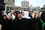 Palestinian women chant slogans during the funeral of Hamas leader Nizar Rayan, and four of his wives and ten of his children, who were killed Thursday in an Israeli airstrike, in the town of Beit Lahiya, northern Gaza Strip, Friday, Jan. 2, 2009. Israel bombed a mosque it says had been used to store weapons and destroyed the homes of more than a dozen Hamas operatives on Friday, the seventh day of a blistering offensive in Gaza and the day after an airstrike killed a prominent Hamas figure. APAIMAGES PHOTO / Ashraf Amra