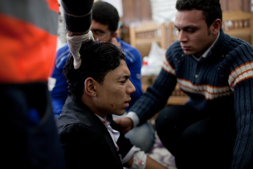 An injured Egyptian protester is treated by volunteers at a field hospital during clashes near Cairo's Tahrir Square, Egypt, November 22, 2011.  Photo: Ed Giles.