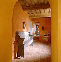 In the hallway egg-yolk yellow distemper and faded pink terracotta tiles radiate warmth and comfort